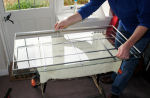 Reassembly of sealed double glazing unit - spacer frame