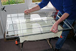 Reassembly of sealed double glazing unit - top pane